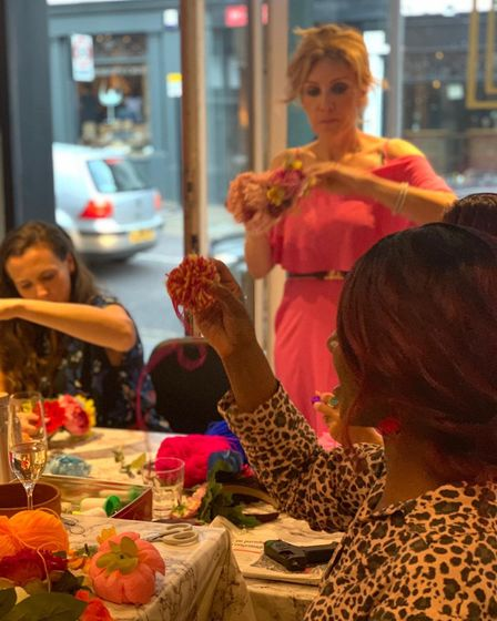 A festival head-dress workshop at Cositas in St Albans run by Sara Galan of Pompones.