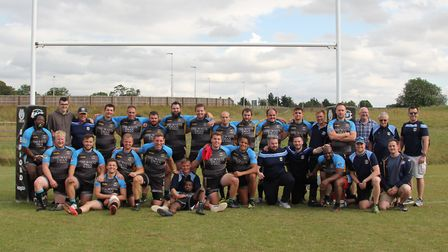 The squad and staff from St Albans Centurions celebrate their 30-28 East League Cup win over Brentwo