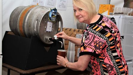 Melbourn Community Showcase 2019: Jeannie Seers pulls a pint. Picture: Clive Porter