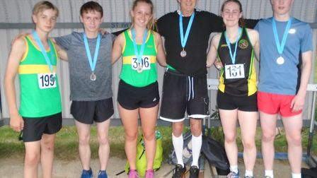 Hunts AC medallists at the Cambridgeshire County Mile Championships are, from the left, Dominic Paul