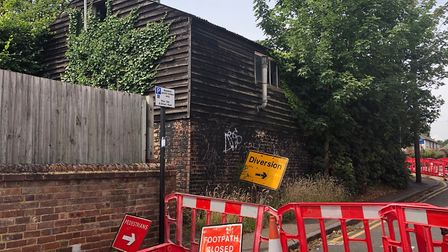 An unstable shed in Old London Road has resulted in the road being closed for months.