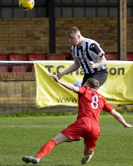 St Ives Town defender Jarvis Wilson in action against Barwell last season. Picture: DUNCAN LAMONT