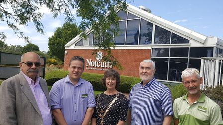 Open Door chairman Kerry Pollard (second from right) celebrating the charity teaming up with Notcutt