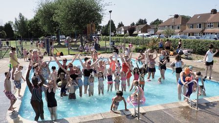 People enjoying the paddling pool at Morris Way playing fields in London Colney. Picture: John Andre