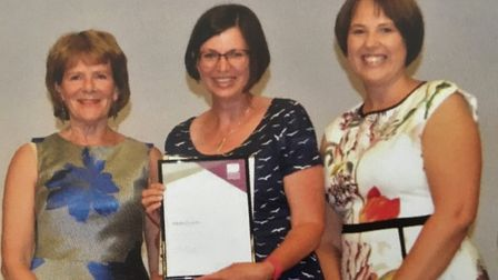 Jillian Graves collecting her teaching award from former Greneway headteachers Sue Kennedy and Laura
