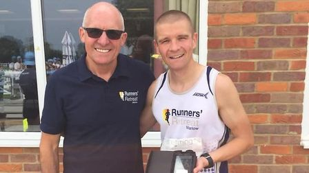 David Hudson (right) collects his prize at the Bearbrook 10k. Picture: SUBMITTED