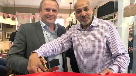 GTR Infrastructure Director Keith Jipps and Hassan Atta open the new coffee shop Rico's at St Neots