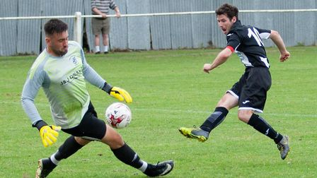 Swaffham's Alex Vincent is denied by Godmanchester Rovers keeper Niall Conroy last Saturday. Picture