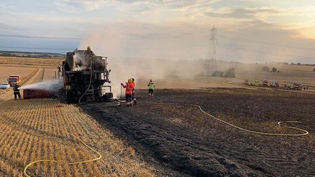 The harvest at a farm in Hamerton ground to a halt on Saturday after a combine harvester caught fire