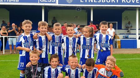 Picture caption: Eynesbury Rovers welcomed players from their Under 6 and Under 7 squads onto the pi
