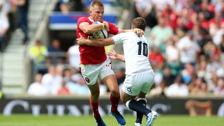 Wales' Gareth Anscombe (left) and England's George Ford during the International match at Twickenham