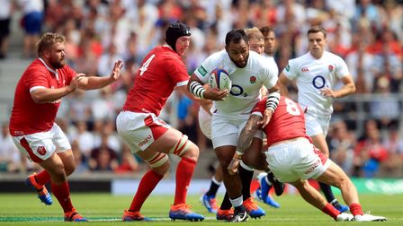 England's Billy Vunipola gets tackled by Wales' Ross Moriarty during the International match at Twic