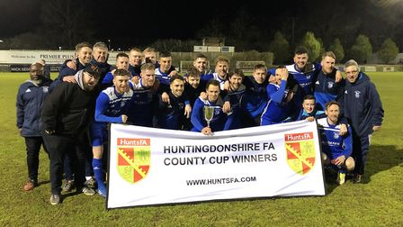 Godmanchester Rovers celebrate their Hunts Senior Cup triumph against St Neots Town back in April. T