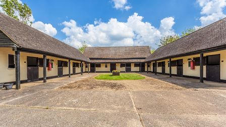 The pretty stable yard includes 12 boxes and a tack room. Picture: Bryan Bishop and Partners