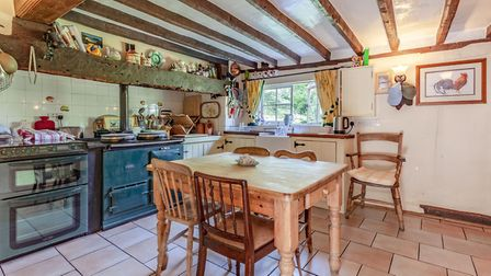 The cosy kitchens adjoins the sitting room. Picture: Bryan Bishop and Partners