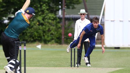 Reed's Zak McGuigan bowls in the match between Letchworth and Reed. Picture: DANNY LOO