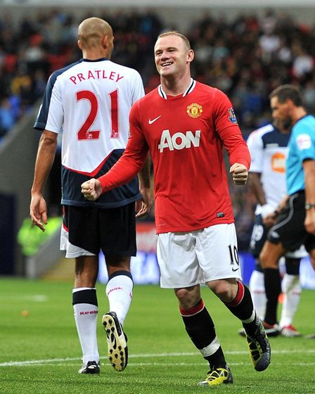 Manchester United's Wayne Rooney celebrates his hat trick during the Barclays Premier League match a