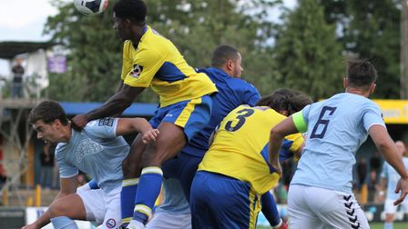 Michael Johnson misses his punch with David Longe-King closing in during St Albans City's 3-0 defeat