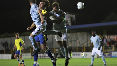 Tom Bender battles in the air during St Albans City's 3-0 defeat to Braintree Town. Picture: JIM STA