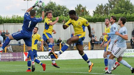 Michael Johnson claims a cross ahead of David Longe-King during St Albans City's 3-0 defeat to Brain