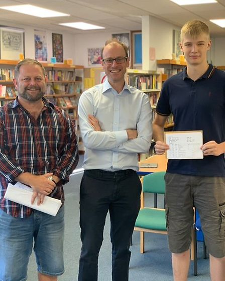 Matthew Cossins who got A* A* A* A* A* from St Neots Sixth Form. Pictured with Mark Taylor and Hyw