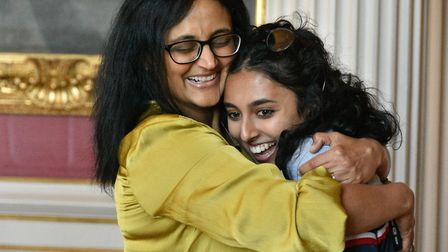 Kimbolton student Anushka Shukla and her mother collecting her results