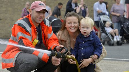 Fireman Woody with Jenson, 2, and mum Abbie Harrison Picture: DUNCAN LAMONT