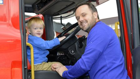 Joshua Gibson, 2, with dad Steve. Picture: DUNCAN LAMONT