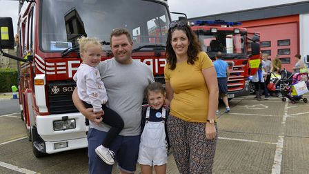 Sam and Kirsty Swales with daughters Briony 3 and Dixie 6. Picture: DUNCAN LAMONT