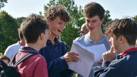 Angus Dent and Ben Smith comparing their grades at Kimbolton School