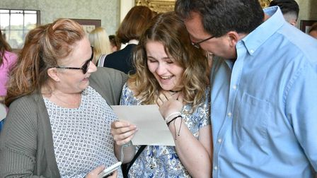 Priya Auton opening her results with her parents at Kimbolton School