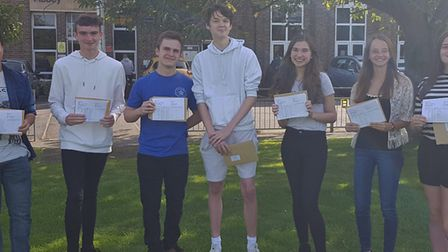 Students at Ramsey Abbey College celebrate after collecting their results