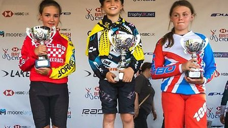 Maggie Brown of Royston Rockets stands on top of the podium at the national championships.