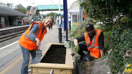 Govia Thameslink Railway's Alex Hambleton (right) and volunteer Joan Meakin (left) paint one of the