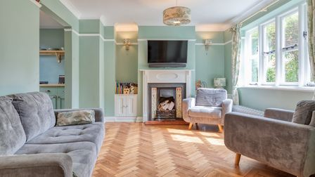 The generous size sitting room has an open fireplace. Picture: Putterills