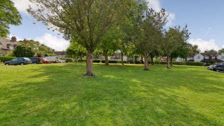 The property overlooks a spacious green. Picture: Putterills