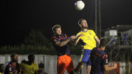 James Kaloczi goes for a header during St Albans City's game against Wealdstone at Clarence Park. Pi