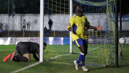 Albert Adu celebrates his first goal for the club during St Albans City's game against Wealdstone at