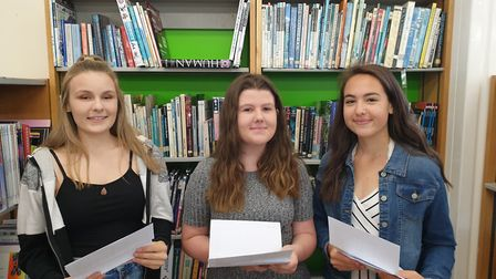 Meridian's Jenna Stressing, Hannah Bird and Charlotte Marriage with their GCSE results. Picture: Cli