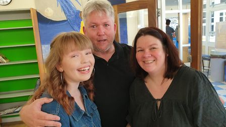 Meridian's Millie Falconer with her proud parents after securing a place at Hills Road Sixth Form Co