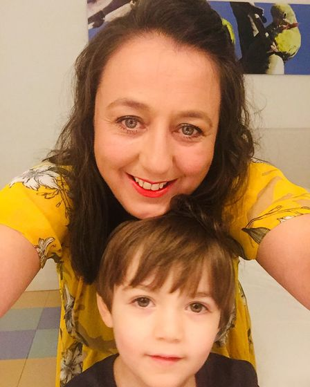Andrea Wright and her five-year-old son Cruz, who is about number 400 on the waiting list for an aut