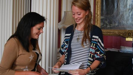 Kimbolton School pupils Thea Dickinson and Leonie Nicks comparing results.