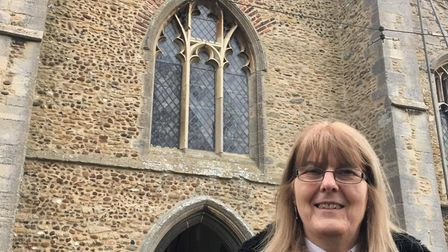 Rector Sheila Anthony outside St Mary's Church, in Bluntisham