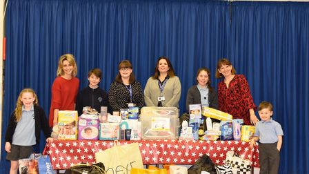 Staff and children of Crabtree School with their donations.