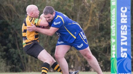 St Ives man Michael Wright puts in a crunching tackle during their Percy Walker Cup triumph against