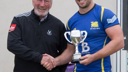 St Ives captain Ollie Bartlett (right) receives the cup from Percy Walker. Picture: PAUL COX