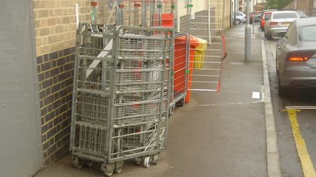 Metal crates left the back of Tesco Express in June. Picture: Ray Dowding