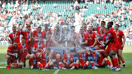 Saracens and Harpenden's Ralph Adams-Hale (back row, second from left) celebrate winning the Gallagh