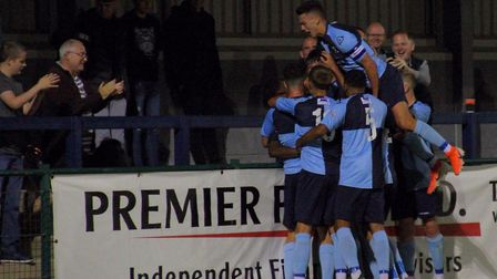 St Neots Town players celebrate one of Prince Mutswunguma's goals against Godmanchester Rovers. Pict
