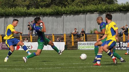 Joe Howe hits a shot for St Albans City against Dorking Wanderers. Picture: JIM STANDEN